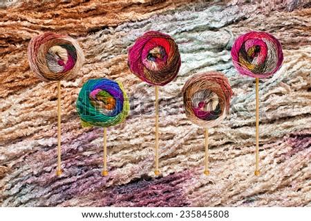 Balls of colorful knitting yarn on bamboo needles - stock photo