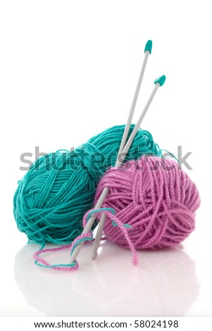 Balls of green and pink  knitting wool or yarn, with silver knitting needles. - stock photo