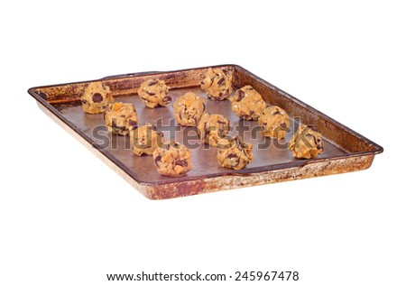 Balls of home-made chocolate and butterscotch chip and oatmeal cookie dough on a pan ready to be baked isolated on white - stock photo