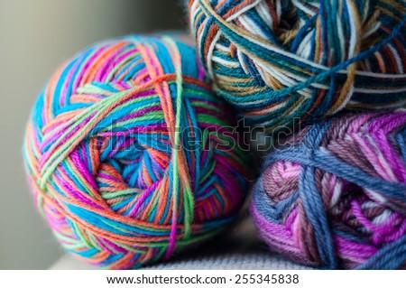 balls of multicolor yarn - stock photo