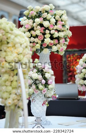 Balls of natural roses as wedding or party decoration  - stock photo