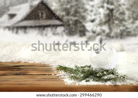 balls of white and silver color and gree tree on brown wooden board  - stock photo