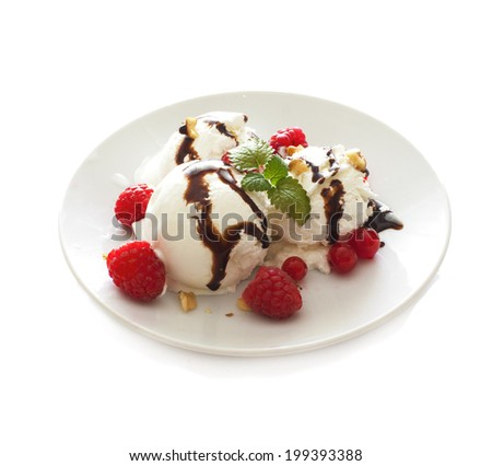 Balls of white ice cream with fresh berries on white plate isolated over white - stock photo