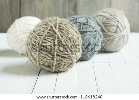 balls of wool on wooden background