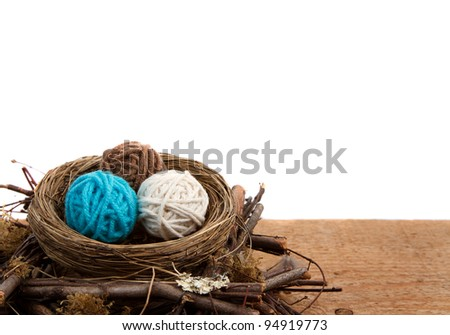 Balls of yarn in a nest easter decoration, on a white isolated background, room for copy space. - stock photo