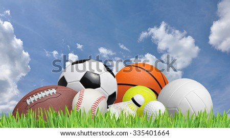 balls on a grass field and a blue sky - stock photo
