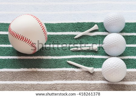 balls on a striped background golf and baseball and nails