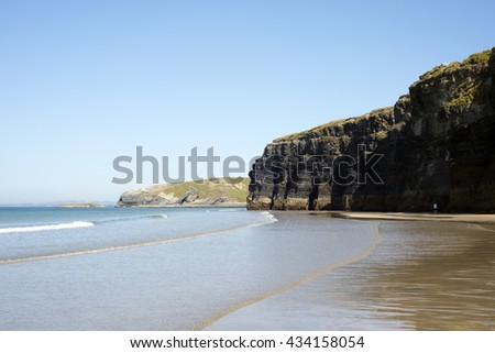 ballybunion beach and cliffs on the wild atlantic way at low tide - stock photo