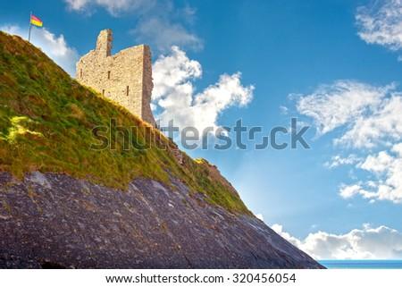 ballybunion castle with the cliff face on the wild atlantic way ireland - stock photo