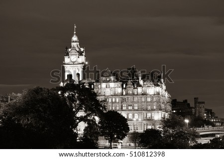 Balmoral Hotel bell tower and Edinburgh city view at night.
