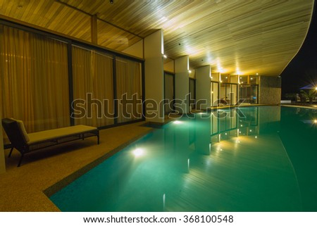 BALOK, MALAYSIA - JUNE 5 2015:Villaku Residence Homestay swimming pools views during blue hour. (Image may contain noise,soft and blurry effect due to long exposure)