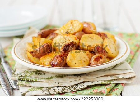 Balsamic Roast Potato with Unpeeled Garlic, Eschalot and Rosemary, copy space for your text - stock photo