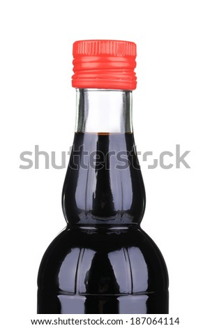 Balsamic vinegar bottle closeup. Isolated on a white background. - stock photo