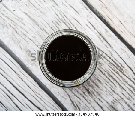 Balsamic vinegar in a mason jar over rustic wooden background - stock photo