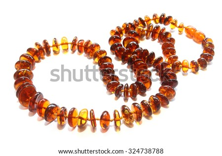Baltic amber necklace isolated on white background - stock photo