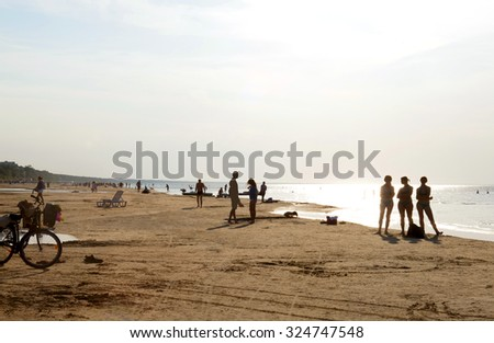 Baltic, Latvia, Jurmala. Silhouettes on an evening beach. - stock photo