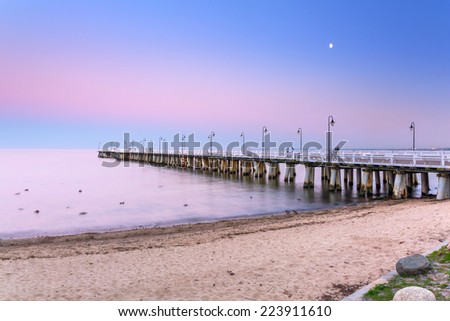 Baltic pier in Gdynia Orlowo at sunset, Poland - stock photo
