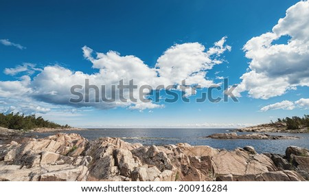 Baltic rocky coastline with a cloudy sky during summer, Sweden - stock photo