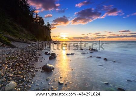 Baltic sea and Cliff of Orlowo at sunrise, Poland - stock photo