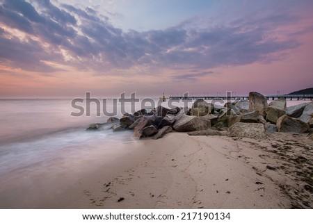 Baltic sea at beautiful sunrise in Poland beach. Orlowo Gdynia - stock photo