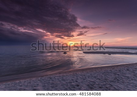 Baltic sea beach on colorful sunset, Poland