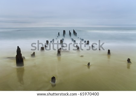 Baltic sea coast photographed with long exposure in pastel colors. - stock photo