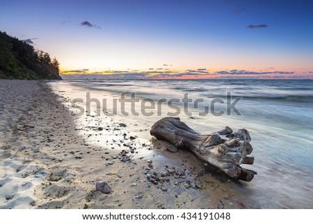 Baltic sea in Gdynia Orlowo at sunrise, Poland - stock photo