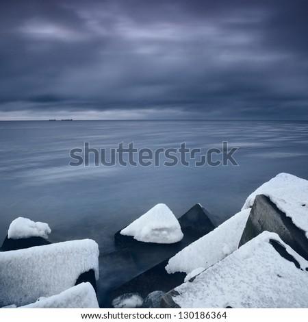 Baltic sea in winter in dramatic mood - stock photo