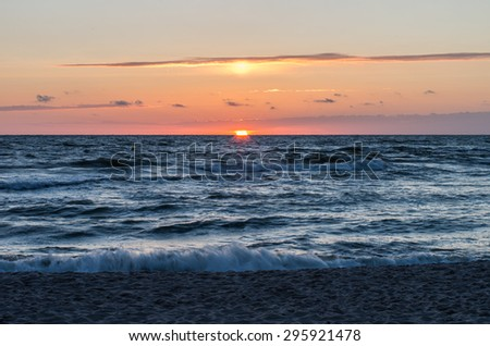 Baltic sea shore at beautiful sunset in Poland, Rowy near Ustka city - stock photo