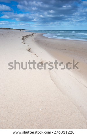 Baltic shore. Beautiful dramatic weather seascape of polish shore of Baltic sea. - stock photo