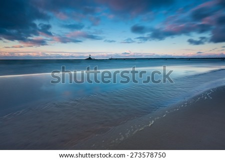 Baltic shore. Beautiful dramatic weather seascape of polish shore of Baltic sea and moutch of Vistula river in Gdansk. - stock photo