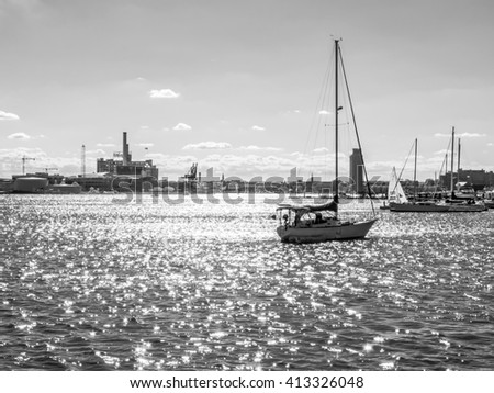 BALTIMORE-APRIL 23 - A black and white view of sailboats and the city off in the distance  from Canton Waterfront Park on April 23 2016 in Baltimore Maryland. - stock photo