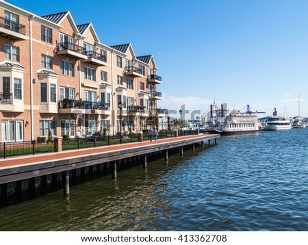 BALTIMORE-APRIL 23 - Luxury waterfront townhouses along the Baltimore Waterfront Promenade on April 23 2016 in Baltimore Maryland. - stock photo