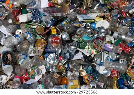 BALTIMORE - CIRCA 2008: Aluminum cans and plastic bottles lie in a heap at an undisclosed recycling facility to be sorted, circa 2008 in Baltimore. The cans and bottles will be compressed and baled. - stock photo