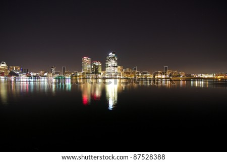 Baltimore City Scape at Night over Harbor - stock photo