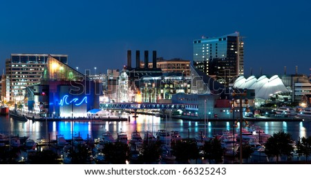 Baltimore Maryland Cityscape at Night:  A view of Baltimore, Maryland�s cityscape overlooking the Inner Harbor and Patapsco River at night. - stock photo