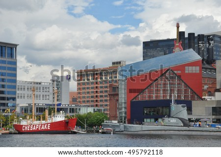 BALTIMORE, MARYLAND - SEP 1: The National Aquarium and the Lightship Chesapeake at the Inner Harbor in Baltimore, Maryland, as seen on Sep 1, 2014.