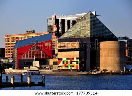 Baltimore, MD - July 23, 2013:  The futuristic Natonal Aquarium located at Inner Harbor with its triangular shapes and geometric wall mural - stock photo