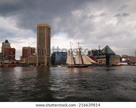 BALTIMORE, MD -  SEPTEMBER 11, 2014: Tall ship Lynx, from Portsmouth, NH, takes an evening sail through Baltimore's Inner Harbor during the Star Spangled Spectacular. - stock photo