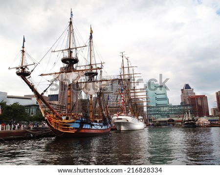BALTIMORE, MD -  SEPTEMBER 11, 2014: Tall ships Kalmar Nyckel and USCGC Eagle are moored and on display for visitors during the Star Spangled Spectacular, honoring the famous Battle of Baltimore.  - stock photo