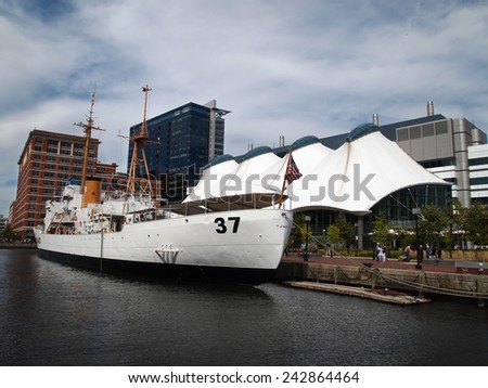 BALTIMORE, MD - SEPTEMBER 14, 2014: USCGC Taney, a popular tourist destination, is moored at Pier 5 in Baltimore's Inner Harbor. The ship was decommissioned in 1986.  - stock photo