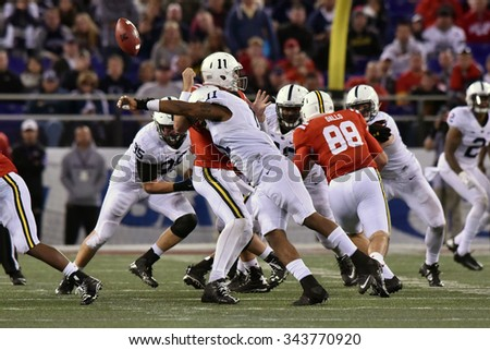 BALTIMORE - OCTOBER 24: Maryland Terrapins quarterback Perry Hills (11) fumbles as he is sacked during the NCAA football game against PSU October 24, 2015 in Baltimore.  - stock photo