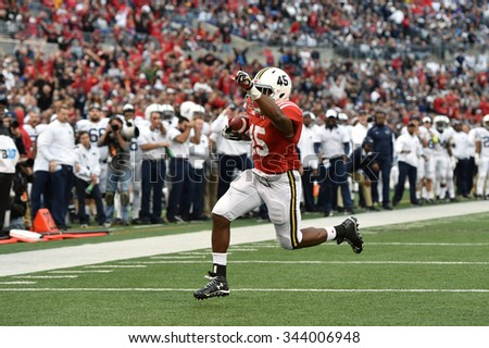 BALTIMORE - OCTOBER 24: Maryland Terrapins running back Brandon Ross (45) scores a rushing touchdown during the NCAA football game against Penn State October 24, 2015 in Baltimore.  - stock photo