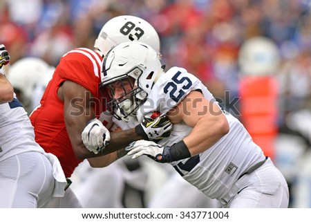 BALTIMORE - OCTOBER 24: Penn State Nittany Lions linebacker Von Walker (25) tries to fight through a block on special teams during the NCAA football game against MD October 24, 2015 in Baltimore.  - stock photo