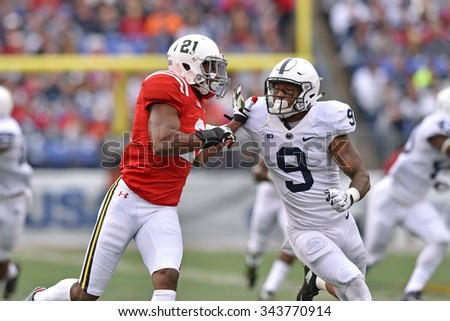 BALTIMORE - OCTOBER 24: Penn State Nittany Lions safety Jordan Lucas (9) blocks downfield on punt coverage during the NCAA football game against Penn State October 24, 2015 in Baltimore.  - stock photo