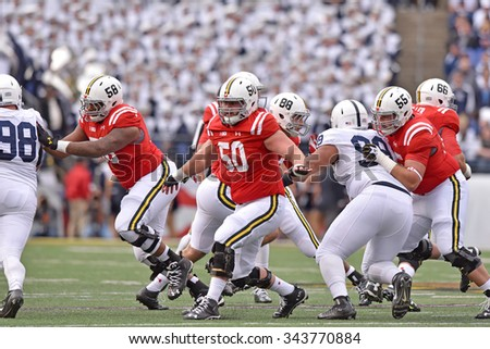 BALTIMORE - OCTOBER 24: The Maryland Terrapins offensive line blocks in pass protection during the NCAA football game October 24, 2015 in Baltimore.  - stock photo