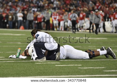 BALTIMORE - OCTOBER 24: Trainers tends to an injured Nittany Lion player during the NCAA football game against Maryland October 24, 2015 in Baltimore.