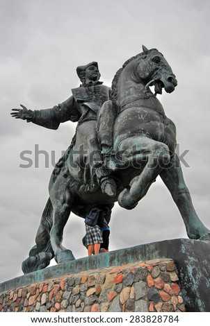 BALTIYSK, RUSSIA - AUGUST 15, 2012: Statue of Russian Empress Elisaveta (Elizabeth) riding a horse. A popular touristic landmark on Baltic Spit, the most western part of Russia. Blue sky background.