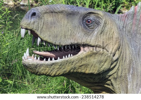 Baltow, Poland - June 12, 2014: Realistic model of dinosaur's head in Jura Park, Baltow on June 12, 2014. Jura Park in Baltow features numerous natural size dinosaurs models.