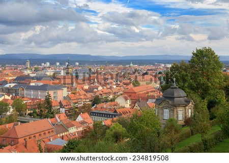 Bamberg cityscape, cloudy top view roofs, Germany - stock photo